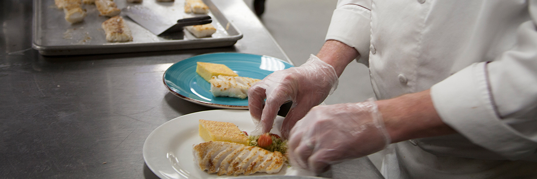 A chef prepares a meal at a Change of Taste event.
